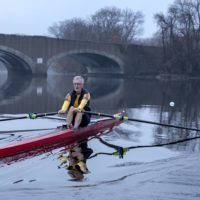 Rower and climate activist Frederick Hewett rows on the Charles River. (Robin Lubbock/WBUR)