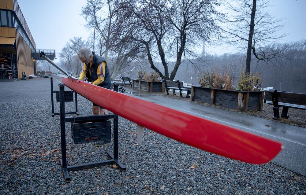 Frederick Hewett prepares a boat at Community Rowing, Inc. for an early morning row on the Charles River. (Robin Lubbock/WBUR)