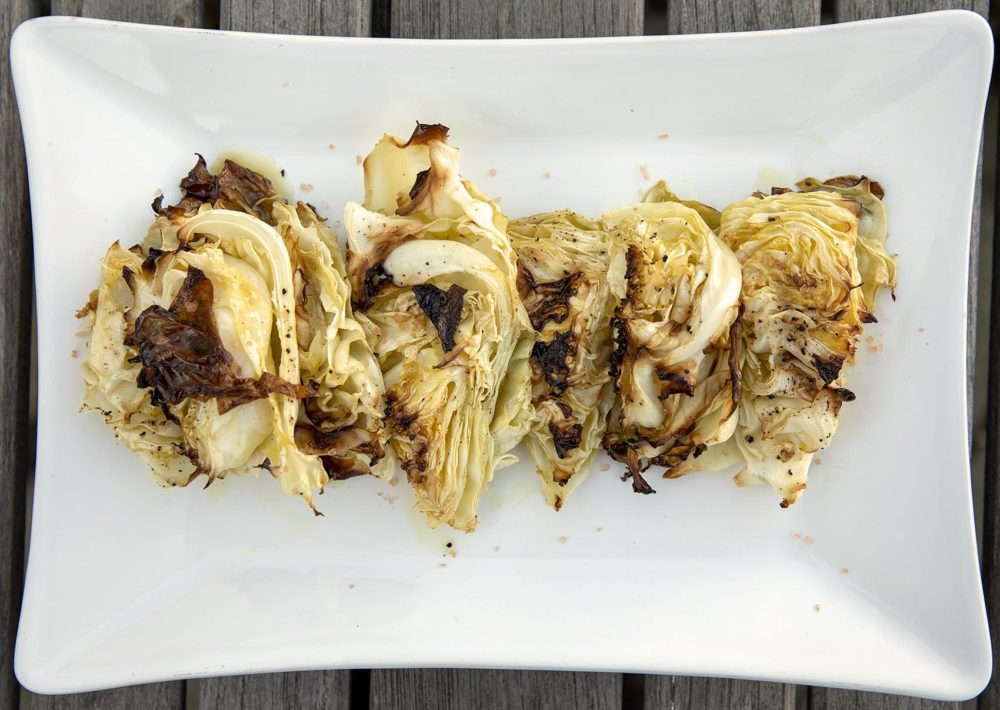 Chef Kathy Gunst's roasted cabbage with chive-mustard-caper vinaigrette. (Robin Lubbock/WBUR)