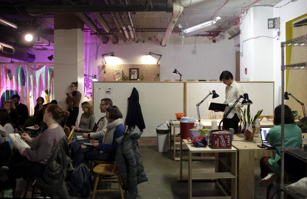 People gather for a figure drawing class at Spaceus in East Cambridge on a Wednesday evening. (Hadley Green for WBUR)