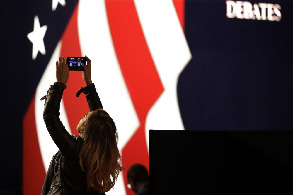 Lena Gjokaj takes a cell phone photo of stage for the presidential debate between Democratic presidential candidate Hillary Clinton and Republican presidential candidate Donald Trump at Hofstra University in Hempstead, N.Y., Monday, Sept. 26, 2016. (Julio Cortez/AP)