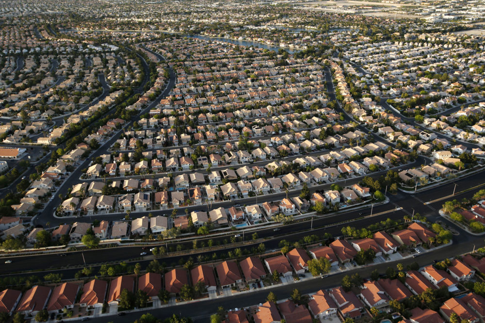Houses line streets near the edge of the Las Vegas valley in Las Vegas. (John Locher/AP)