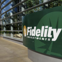 Boston-based Fidelity Investments is one company offering student debt repayment as an employee benefit. It began the program in 2016. (Richard Vogel/AP)