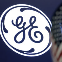 The General Electric logo appears above a trading post on the floor of the New York Stock Exchange. (Richard Drew/AP)