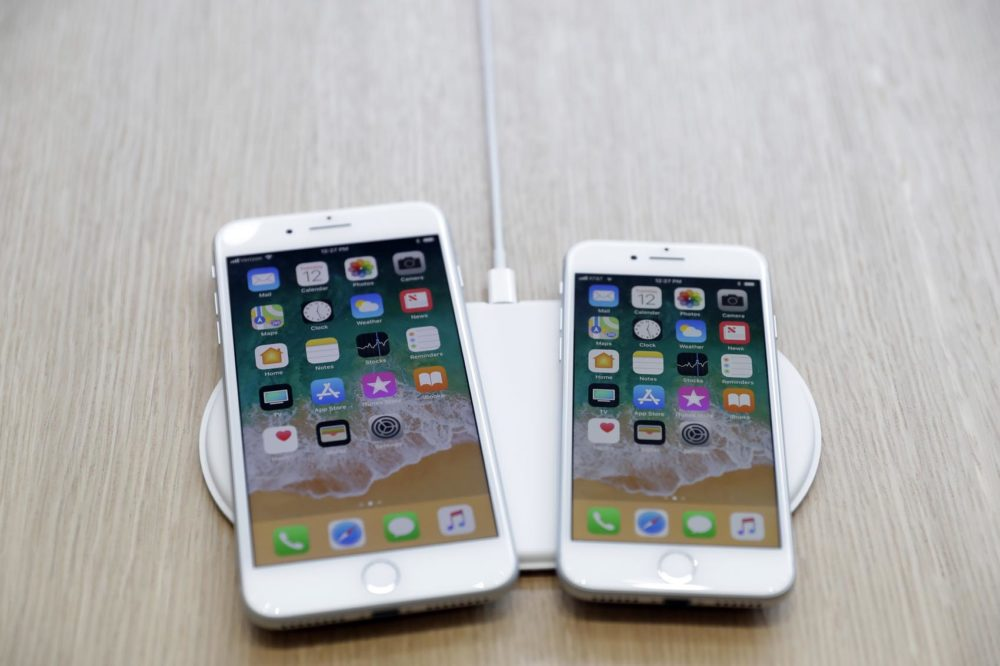 The AirPower wireless charger and iPhones are displayed in the showroom after the new product announcement at the Steve Jobs Theater on the new Apple campus in Cupertino, Calif.,  Sept. 12, 2017. (Marcio Jose Sanchez, File/AP)