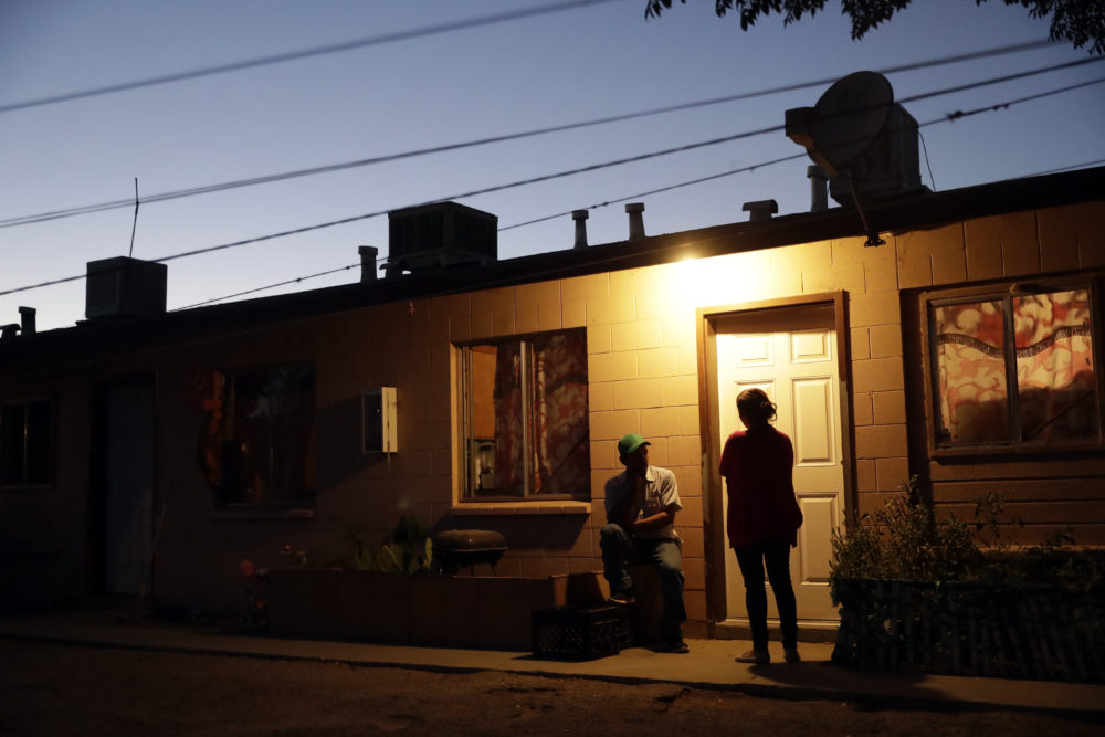 In this Wednesday, Sept, 19, 2018 photo, the sun sets behind an apartment building occupied by farmworkers in Huron, Calif. California may be famous for its wealth, but there is a distinctly different part of the state where poverty prevails: places like this one halfway between Los Angeles and San Francisco. The Central Valley has long been short on resources no matter which political party is in power. (Marcio Jose Sanchez/AP)