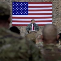 President Donald Trump speaks at a hangar rally at Al Asad Air Base, Iraq, Wednesday, Dec. 26, 2018. (Andrew Harnik/AP)
