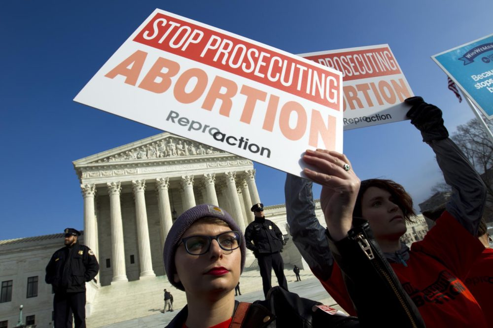 Abortion rights activists protest outside of the U.S. Supreme Court, during the March for Life in Washington, Friday, Jan. 18, 2019. (Jose Luis Magana/AP)