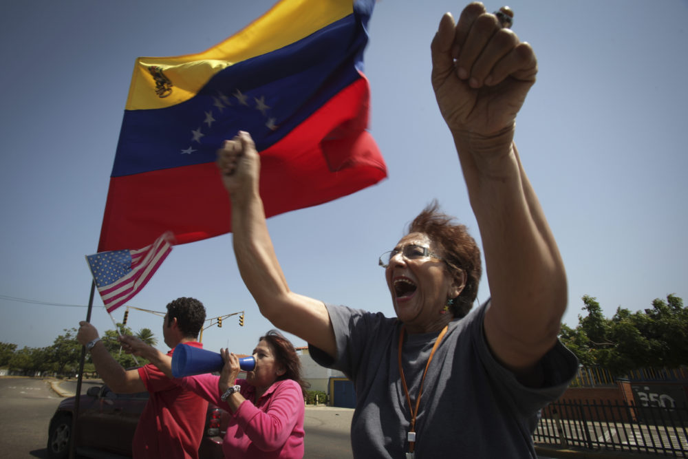 A woman chants anti-government slogans in a walkout against President Nicolas Maduro, in Maracaibo, Venezuela, Wednesday, Jan. 30, 2019. (Boris Vergara/AP)