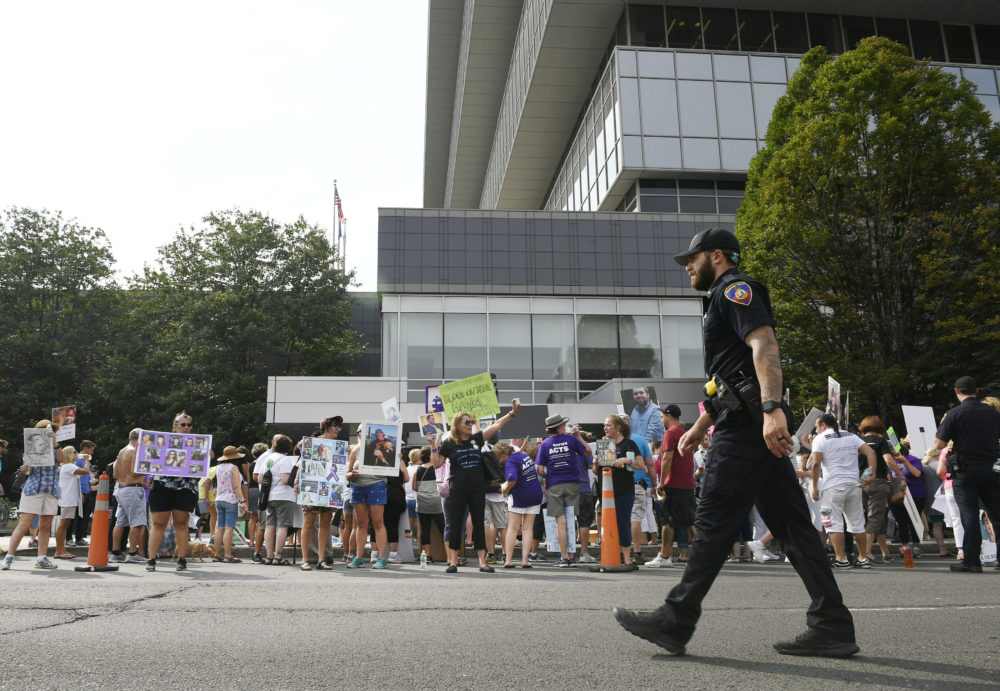 Family and friends who have lost loved ones to OxyContin and opioid overdoses protest outside Purdue Pharma headquarters in Stamford, Conn., in August 2018. (Jessica Hill/AP)