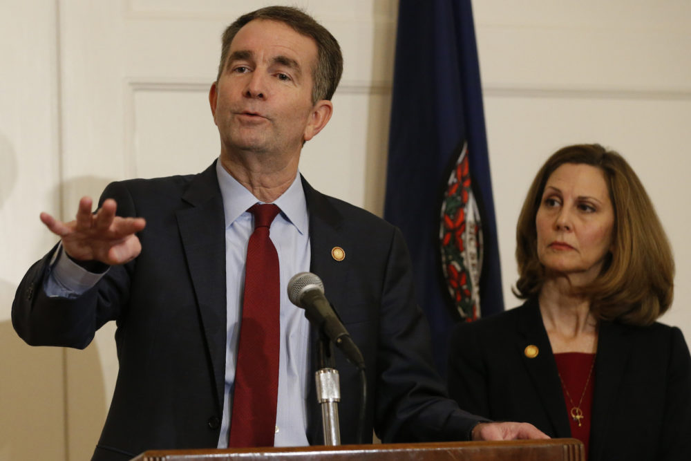 Virginia Gov. Ralph Northam, left, gestures as his wife, Pam, listens during a press conference in the Governors Mansion at the Capitol in Richmond, Va., Saturday, Feb. 2, 2019.  Northam is under fire for a racist photo that appeared on his page in his college yearbook. (Steve Helber/AP)