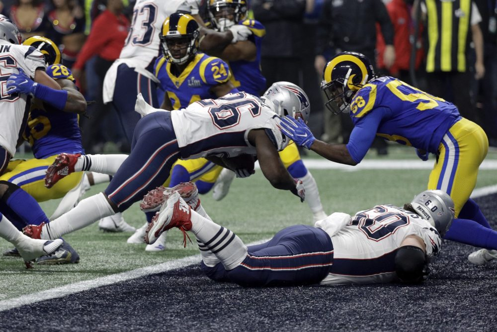 New England Patriots' Sony Michel (26) dives over the goal line for a touchdown in front of Los Angeles Rams' Cory Littleton (58) during the second half of the NFL Super Bowl 53 football game Sunday, Feb. 3, 2019, in Atlanta. (AP Photo/David J. Phillip)