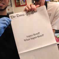 "Brothers Damien Hanford, right, and Matthew Hanford, hold their copy of the mostly blank front page of the New Orleans Times-Picayune newspaper, at Bergeron Boudin and Cajun Meats, in Harahan, La., Monday, Feb. 4, 2019. The newspaper's nearly blank front page summarized what those in the Big Easy think of the New England Patriots' win over the Rams on Sunday: ""Super Bowl? What Super Bowl?"" (Gerald Herbert/AP)"