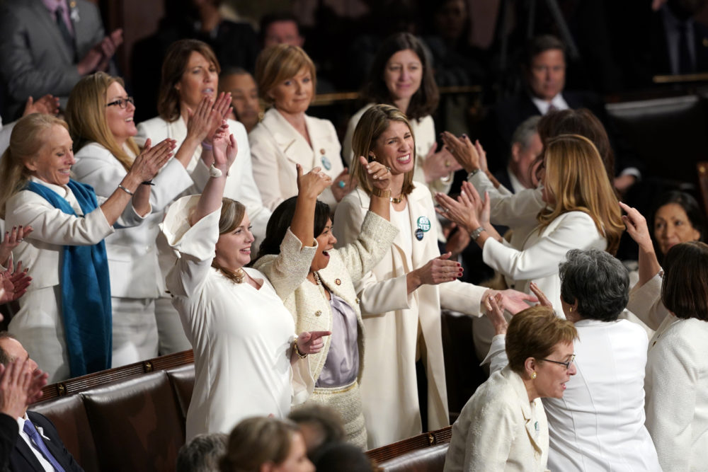 Members of Congress cheer, including Rep. Lori Trahan (center right), after President Donald Trump acknowledges more women in Congress during his State of the Union address to a joint session of Congress on Capitol Hill in Washington, Tuesday, Feb. 5, 2019. Carolyn Kaster/AP)