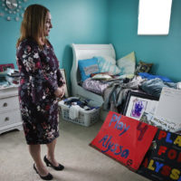 Lori Alhadeff, mother of 14-year-old Alyssa Alhadeff who was one of 17 people killed at Marjory Stoneman Douglas High School, stands in her daughter's bedroom on Wednesday, Jan. 30, 2019, in Parkland, Fla. Much of the teenager's turquoise-colored bedroom remains untouched. (Brynn Anderson/AP)