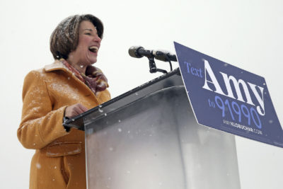 Democratic Sen. Amy Klobuchar, laughs as she addresses a snowy rally where she announced she is entering the race for president Sunday, Feb. 10, 2019, at Boom Island Park in Minneapolis. (Jim Mone/AP)