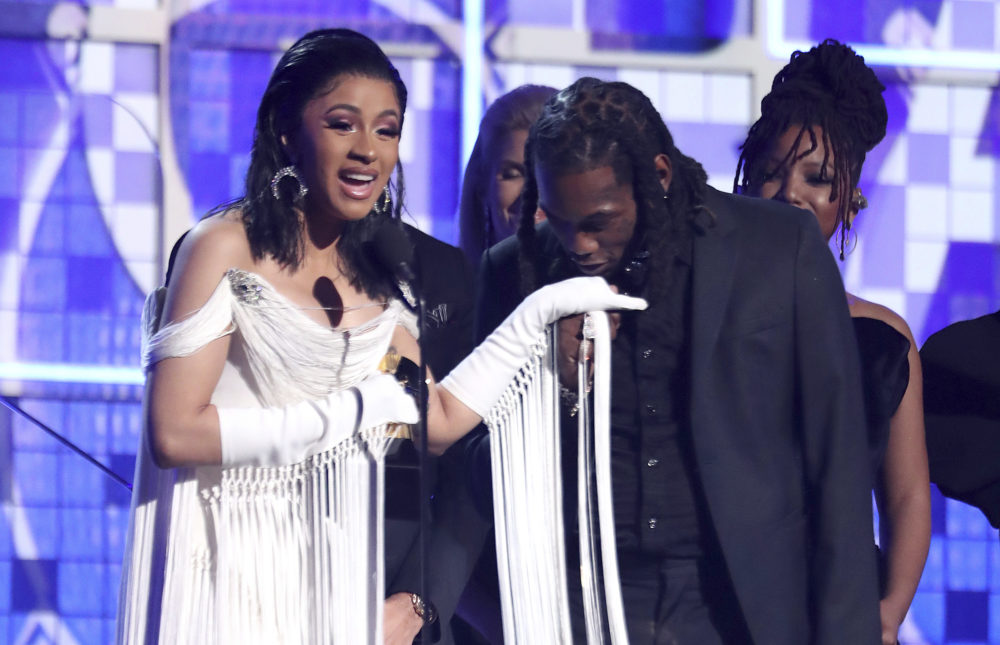 """Cardi B accepts the award for best rap album for """"Invasion of Privacy"""" as Offset kisses her hand. (Matt Sayles/Invision/AP)"""