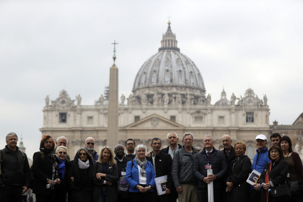 Members of the Ending of Clergy Abuse organization and survivors of clergy sex abuse pose for photographers outside St. Peter's Square, at the Vatican, Monday, Feb. 18, 2019. (Gregorio Borgia/AP)