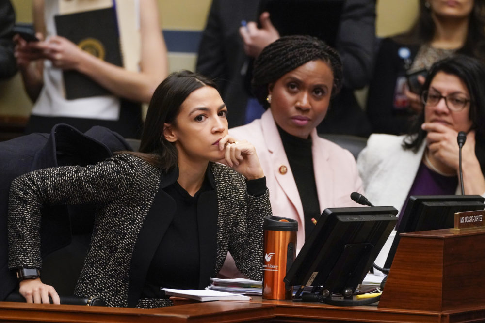 House Oversight and Reform Committee members, from left, Rep. Alexandria Ocasio-Cortez, D-N.Y., Rep. Ayanna Pressley, D-Mass., and Rep. Rashida Tlaib, D-Mich., listen during a committee hearing Tuesday. (J. Scott Applewhite/AP)