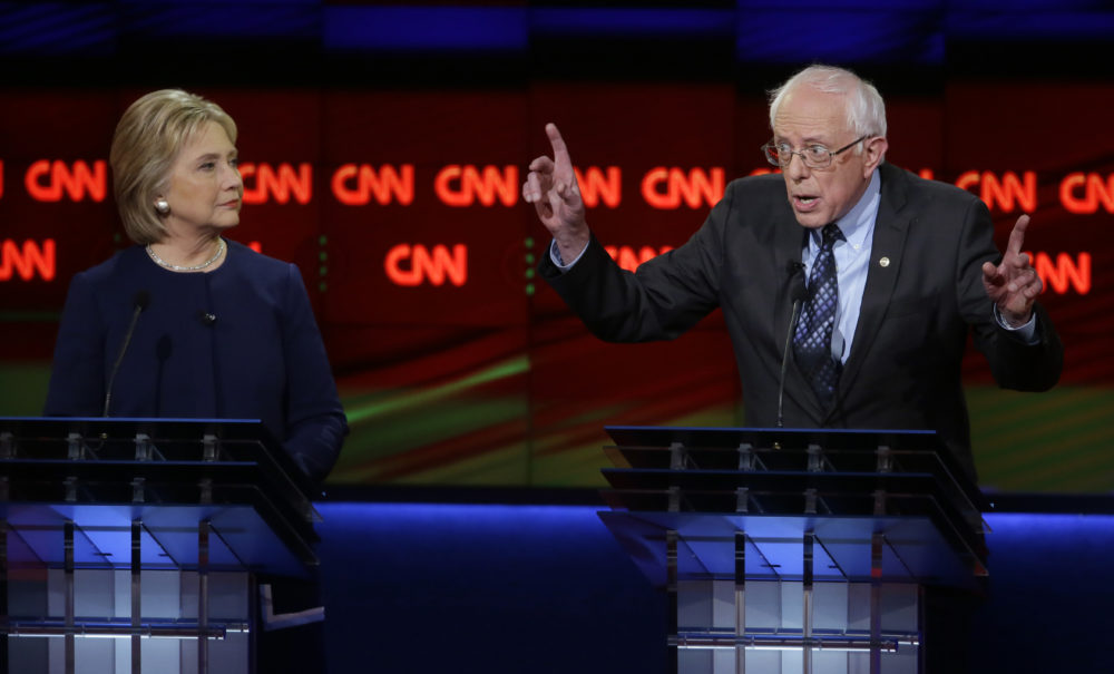 Sen. Bernie Sanders, I-Vt., right, argues a point as Hillary Clinton listens during a Democratic presidential primary debate at the University of Michigan-Flint, Sunday, March 6, 2016. (AP/Carlos Osorio)
