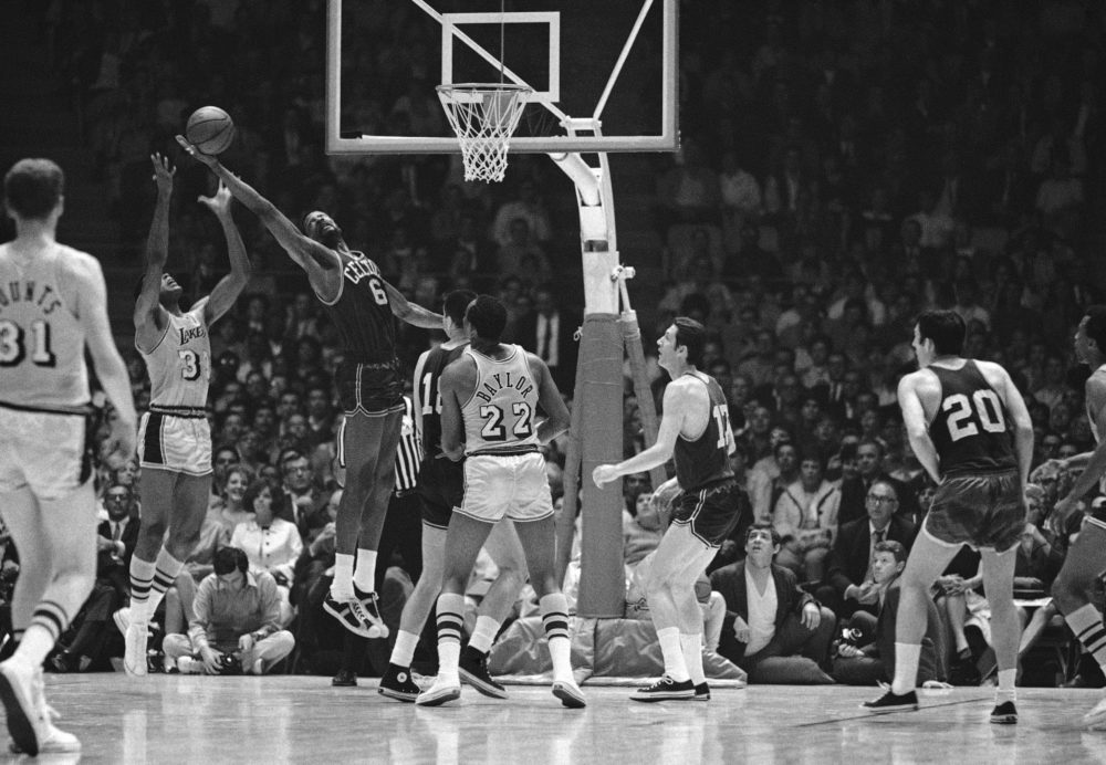 The Boston Celtics' Bill Russell (6) snags the ball away from the Lakers' Tom Hawkins, left, during the game in Los Angeles April 27, 1968. (AP)