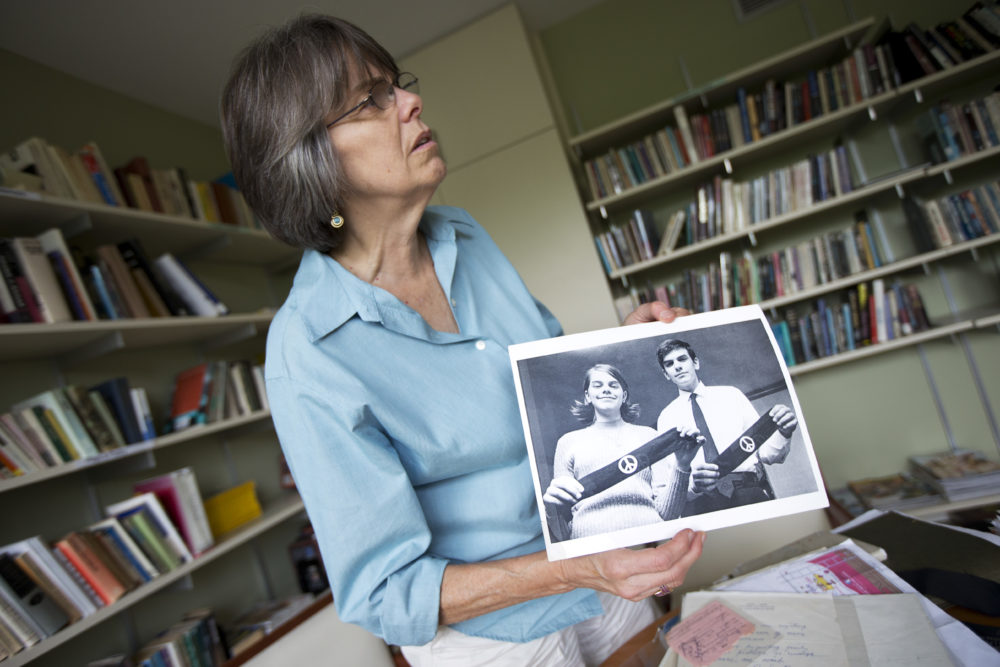 """In this photo taken Tuesday, Aug. 27, 2013, Mary Beth Tinker shows a photograph during an interview in Washington. Tinker was just 13 when she spoke out against the Vietnam War by wearing a black armband to her Iowa school in 1965. When the school suspended her, she took her free speech case all the way to the U.S. Supreme Court and won. Her message: Students should take action on issues important to them. """"It's better for our whole society when kids have a voice,"""" she says. (Manuel Balce Ceneta/AP)"""