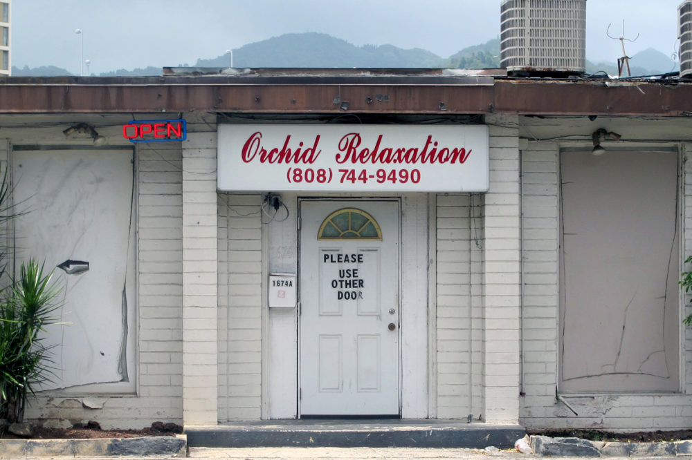 An open sign hanging outside Orchid Relaxation in Honolulu,  May 6, 2015. The massage parlor was one of several local businesses that were targeted in a police prostitution sting. (Jennifer Sinco Kelleher,File/AP)