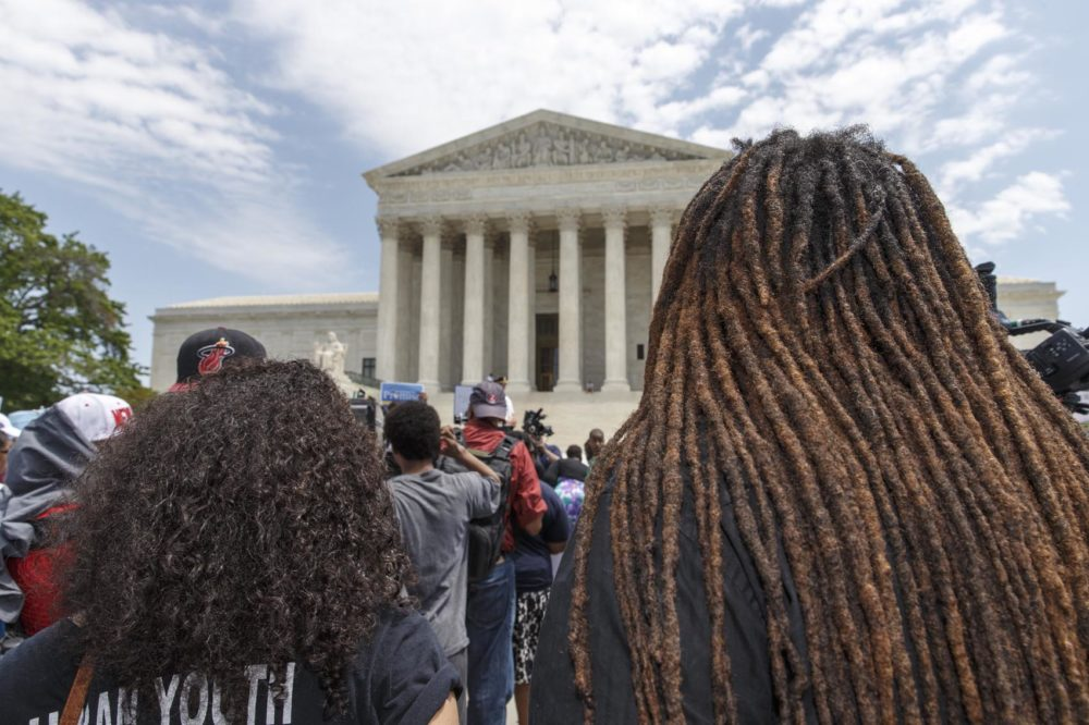 "Students, parents and educators rally at the Supreme Court in Washington, Tuesday, May 13, 2014, on the 60th anniversary Brown v. Board of Education decision that struck down the ""separate but equal"" concept established under Plessy v. Ferguson that kept schools segregated. (AP Photo)"