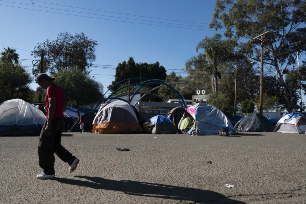 A man walks by an encampment of tents in Tijuana, Mexico where some refugees were living outside the Benito Juarez Soccer Stadium. (Courtesy Jozef Staska)