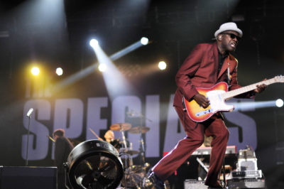 """British guitarist Lynval Golding performs with his band """"The Specials"""" during the Eurockeennes Music Festival in July 2010 in Belfort, France. (Sebastien Bozon/Getty Images)"""