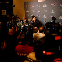 Tom Brady speaks to the media before Super Bowl LIII. (Kevin C.  Cox/Getty Images)
