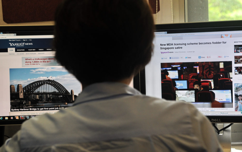A person browses through media websites on a computer in Singapore.  (Roslan Rahman/AFP/Getty Images)
