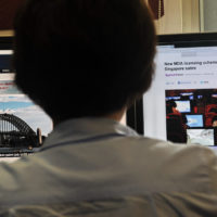 A person browses through media websites on a computer in Singapore on May 30, 2013. (Roslan Rahman/AFP/Getty Images)