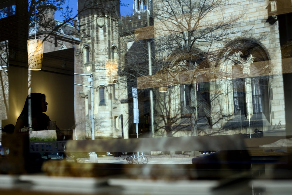 Patrons sit in the Atticus Bookstore Cafe, which overlooks the Yale University campus, on Chapel Street in New Haven, Conn. (Christopher Capozziello/Getty Images)