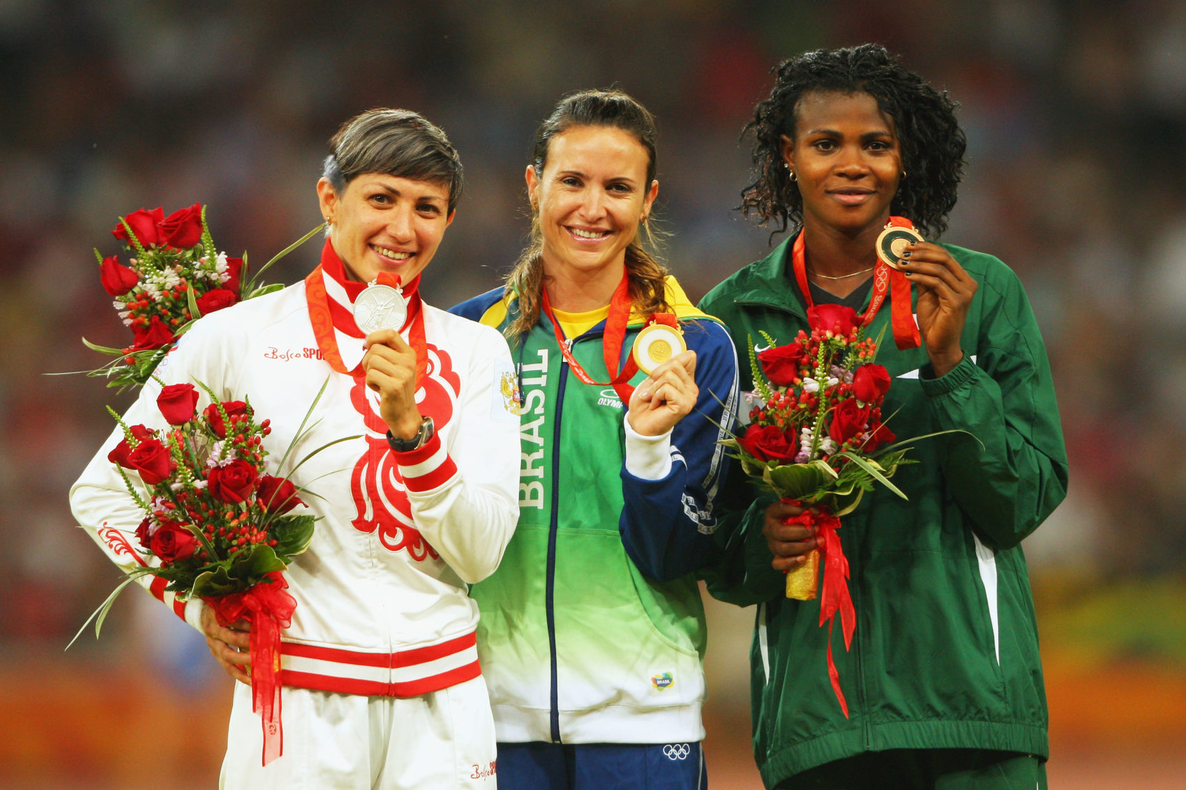 Blessing Okagbare (right) receives her medal at the 2008 Olympic Games. Tatyana Lebedeva (left) was later disqualified for doping and stripped of her silver medal. (Stu Forster/Getty Images)