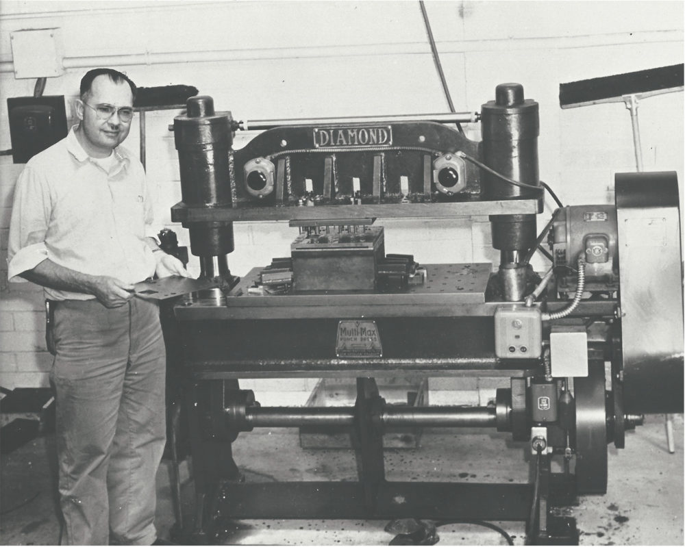 Leo Fender stands with a Diamond punch press in 1950. (Courtesy of Richard Smith)