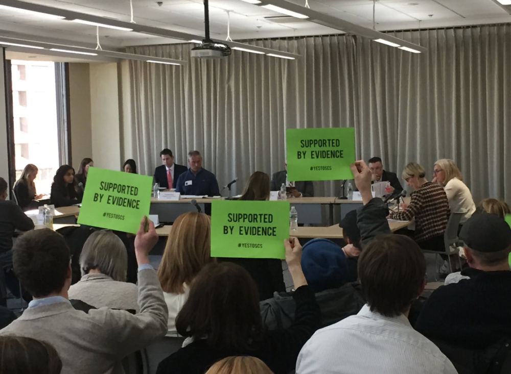 Although public comments were not allowed during Tuesday's special commission meeting on supervised consumption sites, supporters found a way to weigh in. (Martha Bebinger/WBUR)