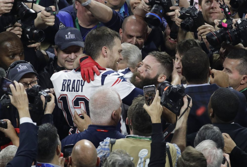 New England Patriots' Julian Edelman, right, and teammate Tom Brady celebrate after the Super Bowl. (Charlie Riedel/AP)