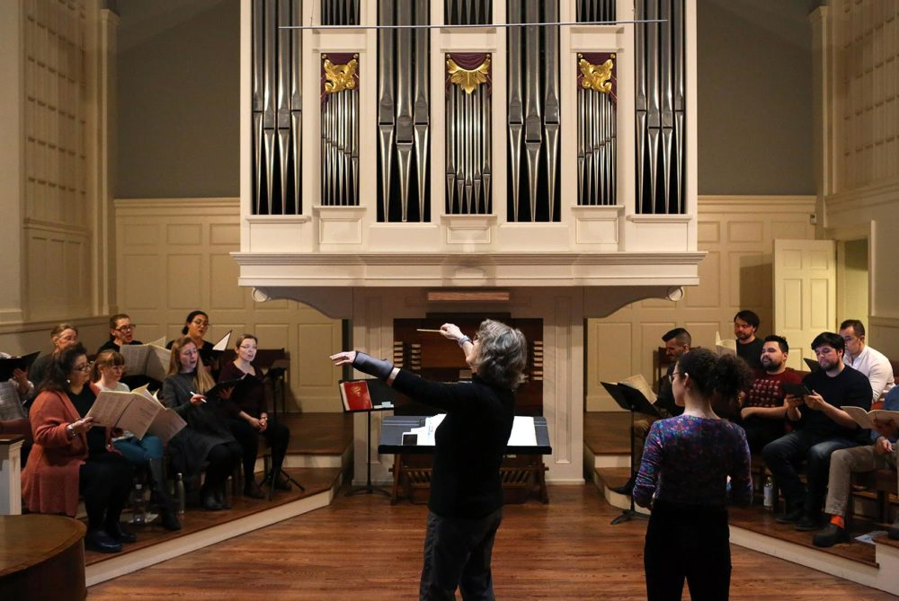 The Cappella Clausura practices for upcoming performances of Fanny Mendelssohn Hensel's 3 cantatas at the Eliot Church in Newton. (Hadley Green for WBUR)