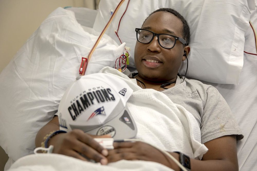 Brunel Etienne receives a blood transfusion at the Kraft Blood Donor Center in Boston. (Robin Lubbock/WBUR)