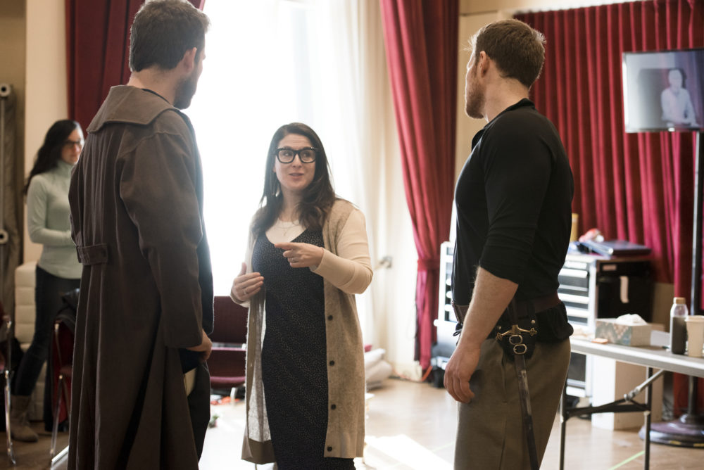 Director Sarna Lapine discusses a scene with Brandon Cedel and Duncan Rock. (Courtesy Liza Voll)