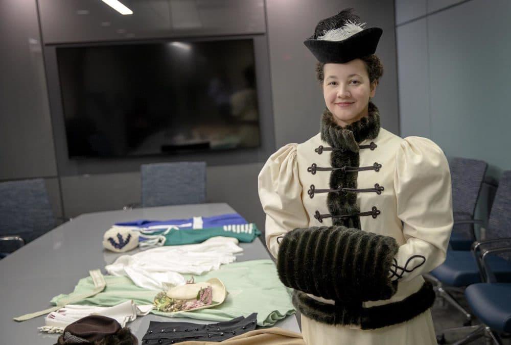 Quinn Burgess, wearing her design of an 1895 skating ensemble with velvet hat and muff, at WBUR's studios in Boston. (Robin Lubbock/WBUR)