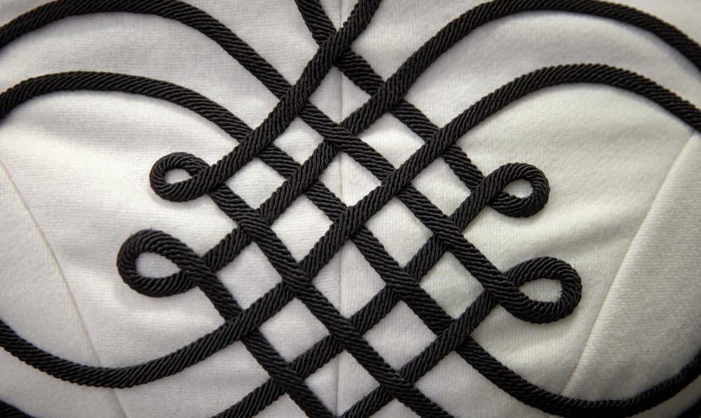 Detail on the back of the Quinn Burgess' 1895 skating ensemble jacket. (Robin Lubbock/WBUR)
