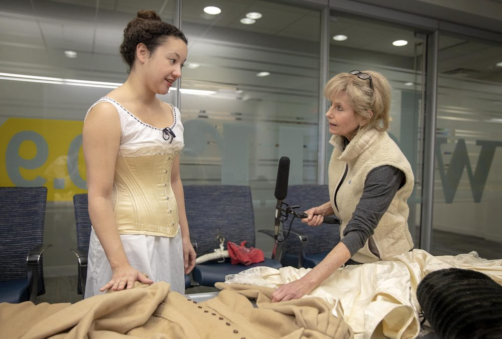 Quinn Burgess, left, in a corset she made, talks with Here & Now's Robin Young. (Robin Lubbock/WBUR)