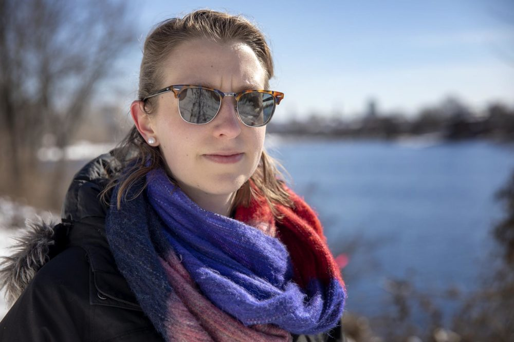 Gabby Queenan, policy director of the Massachusetts Rivers Alliance, stands by the Charles River. (Robin Lubbock/WBUR)