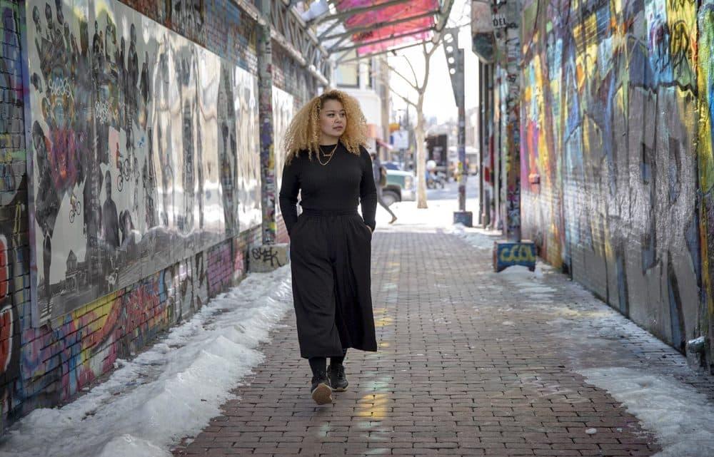 Sneha Shrestha, walks through the graffiti alley in Central Square, Cambridge. (Robin Lubbock/WBUR)