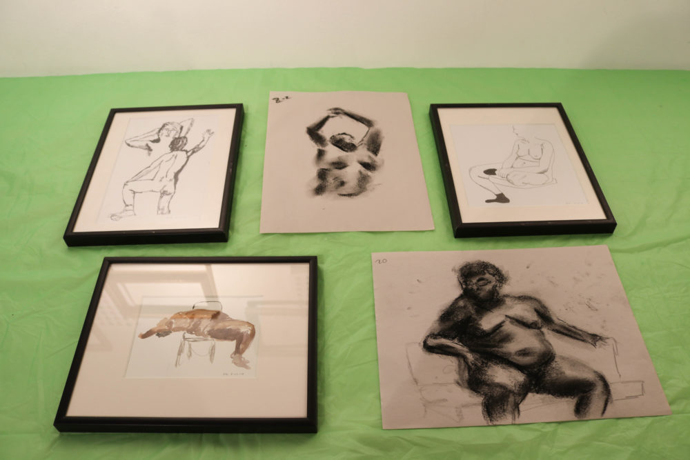"""A selection of submissions to the gallery show """"The Figure is Queer."""" (Olivia Deng for WBUR)"""