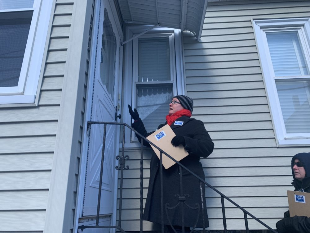 Nonprofit worker and mayoral candidate Erica Scott-Pacheco canvases registered voters on a freezing cold weekday morning in Fall River. (Simón Ríos/WBUR)