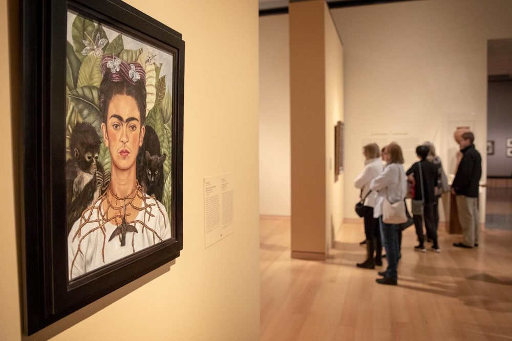 Visitors at the Frida Kahlo exhibition at the MFA. (Robin Lubbock/WBUR)