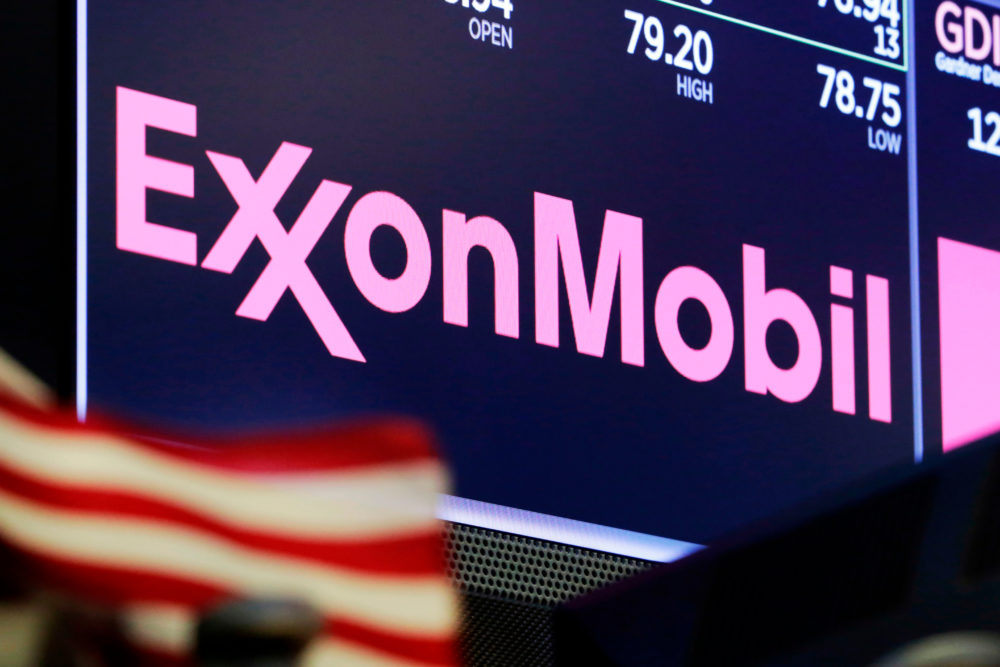 This April 23, 2018 file photo shows the logo for ExxonMobil above a trading post on the floor of the New York Stock Exchange. (Richard Drew/AP)